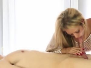 Busty masseuse jerks cock