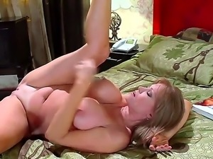 Darla Crane is a hot housewife with large tits. She is reading a romantic...