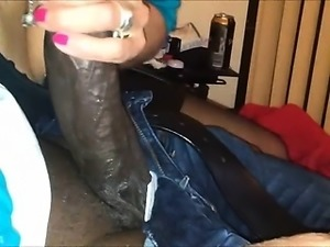 Horny grandma eating a big black cock.
