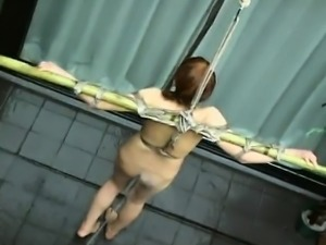 Tied up Asian babe soaked with a water hose