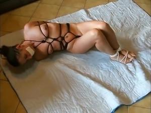 Slave struggle on floor in bondage