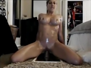 Oily girl fucks her pussy with dildo