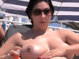 Huge tits French amateur topless at the beach