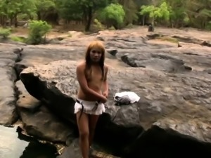 Redhead ladyboy shows off tiny tits and strokes small cock