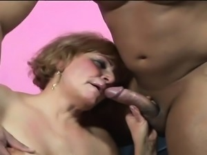 Buxom granny rubs her clit while a hard cock drills her aching pussy