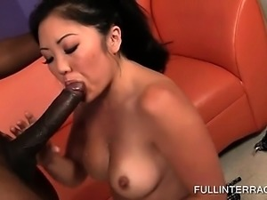 Asian beauty takes black shaft in all her holes