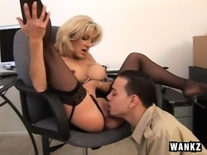 Big breasted milf boss has a young man licking and fucking her snatch
