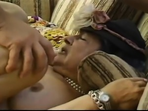 Lustful granny with big boobs has a young man banging her hairy peach