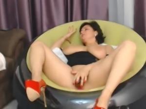 Milf cums riding a dildo