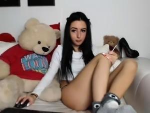 Exciting brunette schoolgirl sensually spreads her lovely l