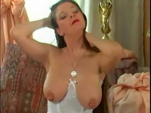 German Girl plays with her large pierced nipples 2