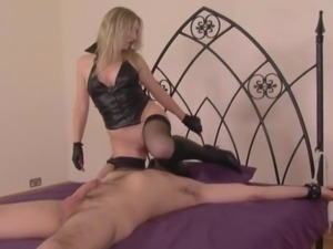 Mistress uses his tied body for her pleasure.....teasing his cock with her...