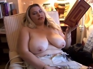 Gorgeous chubby honey in suspenders with nice big tits plays with her soaking...