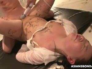 Asian babe tied up and bdsm treated to a nasty session