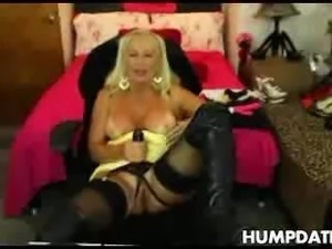 Busty blonde MILF plays with her strapon