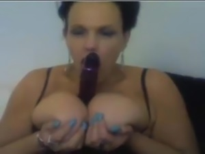 Big tit mature gagging on dildo