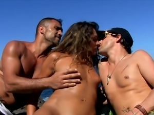 Guys visit the beach with a sexy slut and double team her