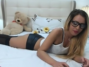 Nerdy blonde girl in black stockings spreads her body acros