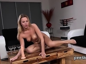 Stellar sweetie is pissing and rubbing smooth quim