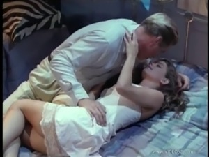 Husband and wife enjoying a hardcore threesome in their bedroom