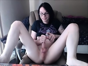 Tranny Cutie With Glasses with a Hard Cock