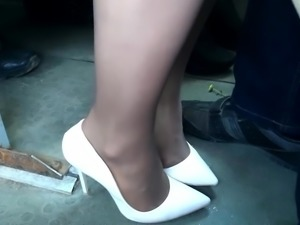 Candid white high heel pumps