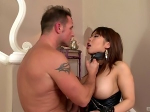 Chubby Asian slave in leather gets pounded by her master
