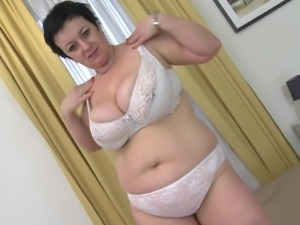 Big beautiful woman with massive curves engages in the masturbation