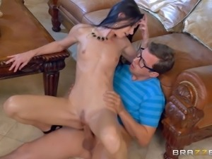 Experienced dark-haired chick with natural tits and a huge dick