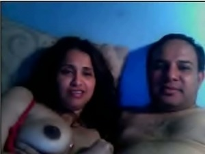 Indian amateur milf with her hubby flashing her boobs
