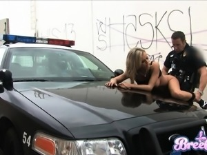 Busty blonde sucks a cop's hard cock and gets creampied after a good outdoor...