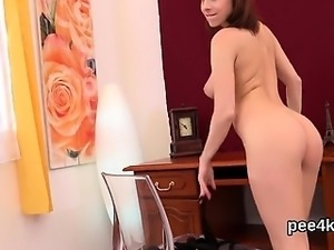 Charming sweetie is pissing and fingering bald slit