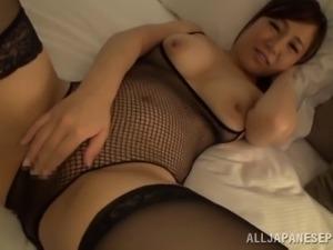 Glamorous Japanese bimbo in fishnet stocking smashing her pussy with massive toy