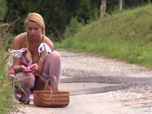 Cute German girl in braided pigtails fucks on a grassy hill