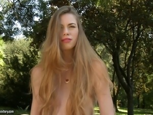 Supremely gorgeous skinny girl fucks a toy in the grass