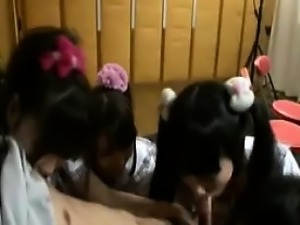 Four beautiful and horny Japanese girls working their lips