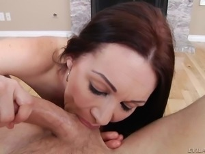 Good looking naked MILF Rayveness with big knockers shows off her assets as...