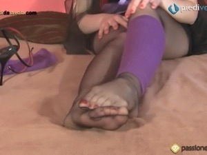 Zoomed in sexy foot fetish action of nylon covered feet