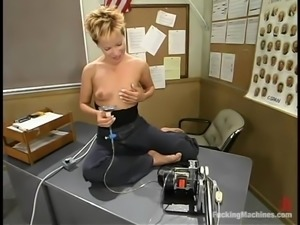 Slutty blonde Emily takes a crazy ride on a fucking machine