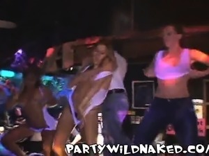 Drunk party babes are showing off their super knockers in a bar