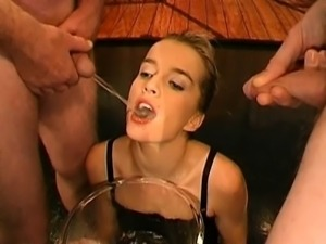 Lovely babe's mouth is filed with jism during blow bang