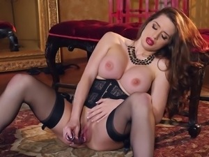 Lingerie clad solo model masturbates with a toy in a teasing shoot
