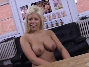 Busty blonde beauty stuffs her shaved pussy with hard meat in casting