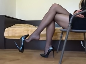 Dangling my black stiletto high heels wearing black stocking