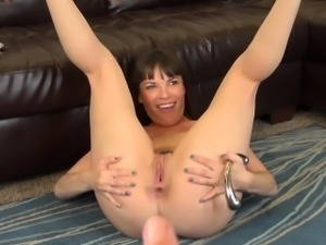 Sexy Dana DeArmond spreads her lovely legs and pleases her fiery holes