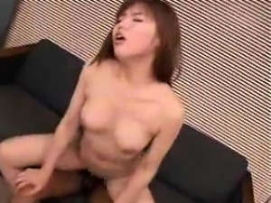 Striking Asian girl with big hooters fucks a stiff cock on
