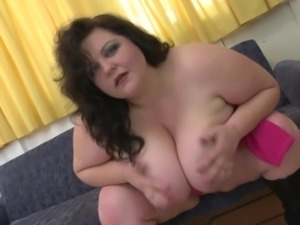 Busty BBW squeezes her big melons before soaking a humongous dildo in her cunt
