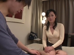 Pretty milf in a sweater treats him to a good fucking