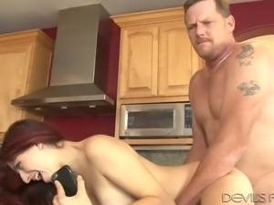 Good looking redhead Nikki Knightly likes to have sex in the kitchen
