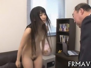 Cute japanese merely gives oral sex during 3some